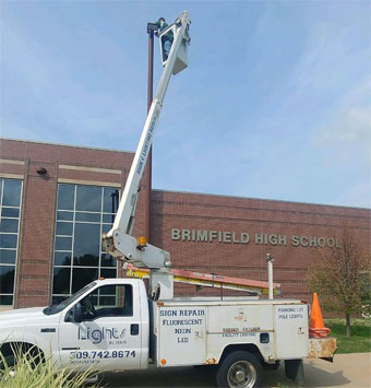 Upgrading a pole light to LED outside Brimfield High School