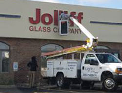Repairing an exterior building sign at Jolliff Glass