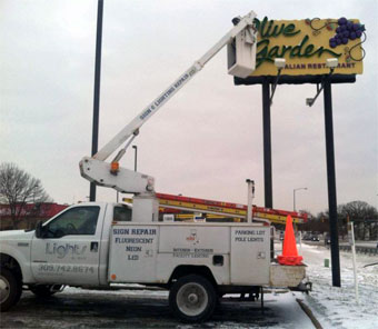 Repairing a neon sign at Olive Garden in Peoria