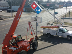 Installing a new Domino's road sign