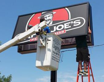 Repairing a fluorescent Happy Joe's sign