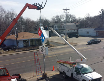 Installing new LED road sign at Domino's on Western